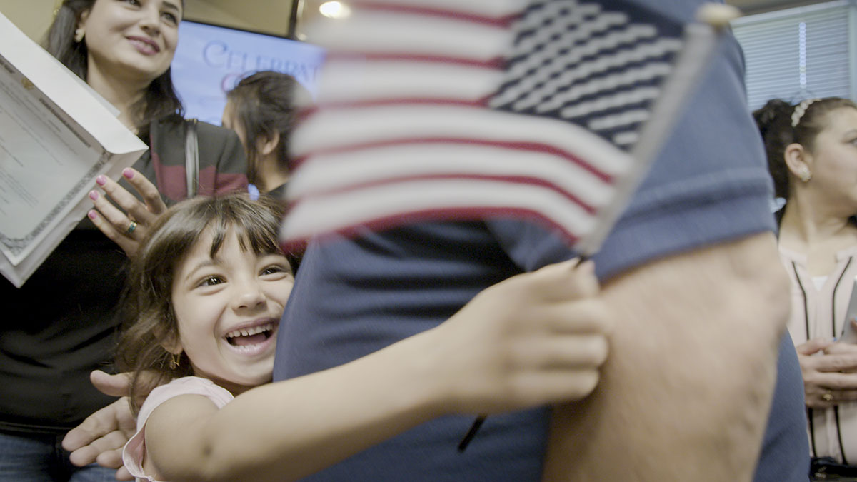 Immigrants in Boise celebrate after a citizenship ceremony.